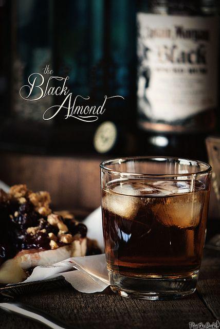 The Black Almond - 2 oz almond liqueur, 2 oz orange liqueur, 4 oz Captain Morgan Black Spiced Rum, 7.5 oz ginger ale (makes 2)