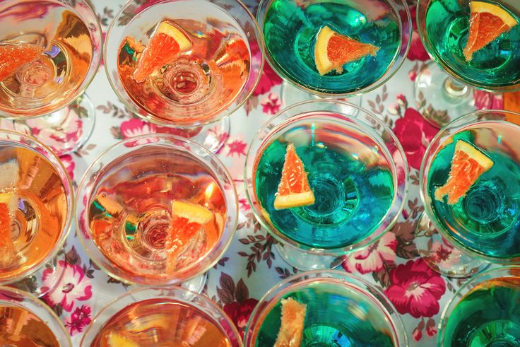 Champagne pink and blue with slices of grapefruit.