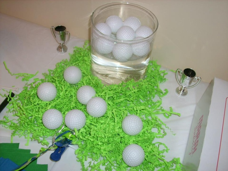 Golf party fill clear vases up with water and float plastic golf balls in them