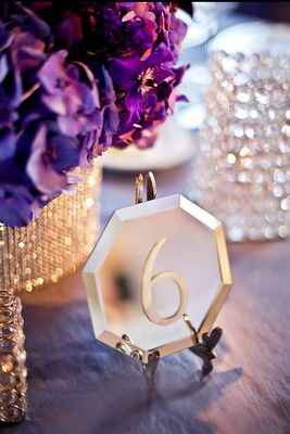 Glass etched mirrored table numbers. Looks modern and chic.