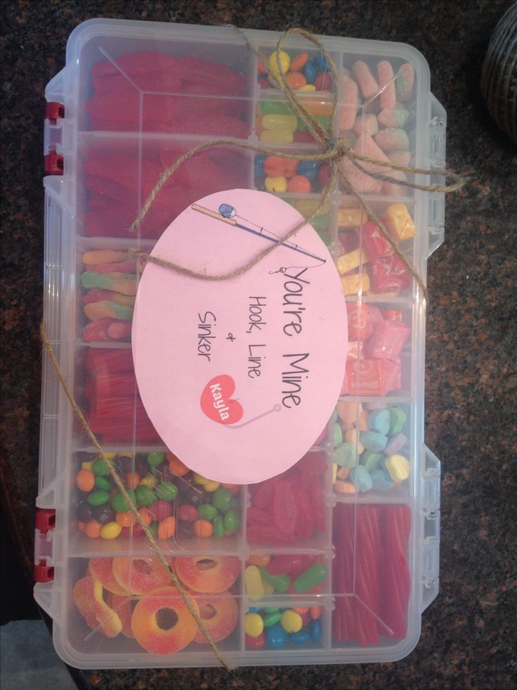 Valentine's Day present for my boyfriend bought a tackle box and stuffed it with his favorite candies and a few that looked like fishing gear like, Swedish Fish, Sour Gummy Worms, Peach Rings, Twizzlers, etc. I printed the cute sign from picmonkey.com and I finished it all off with some twine to make it look even more manly