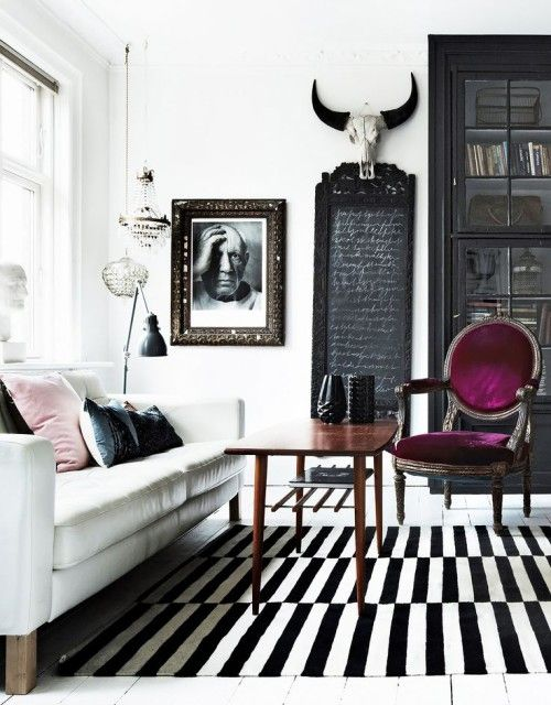 Black and White living room, with skull wall accessory, purple Louis chair and blush accent cushion | skull decor | monochrome home decor