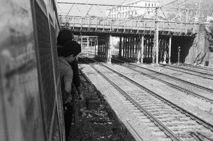 Mumbai Train Yard by Xavier Bartholomew Scanlon