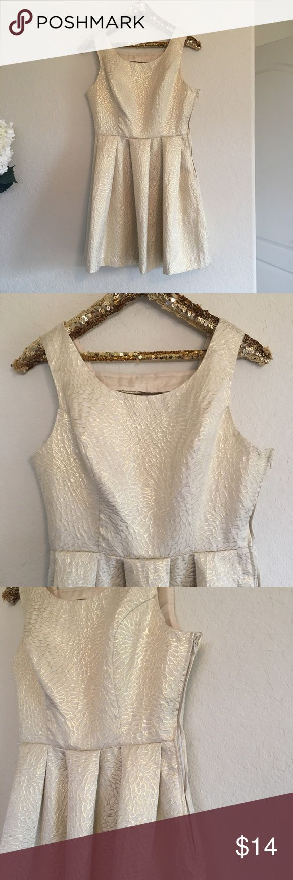 GB Gold Holiday Dress ✨ This beautiful GB holiday dress is in great condition! It's perfect for a Christmas party! ✨ The bows on the back make this dress even cuter! There's a very faint flaw in the print on the back, but only noticeable upon close inspection.  🚭 From a smoke-free home ❌ No trades or off PoshMark sales 🛍 Bundles welcome and encouraged 👌🏻 Reasonable offers welcome ⚡️ Same/next day shipping 🌬 All items are steamed before shipping GB Dresses