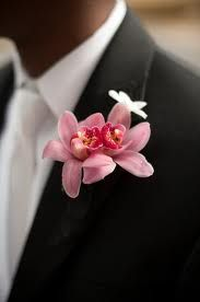 Hubby will be wearing a black tux with a pink flower.