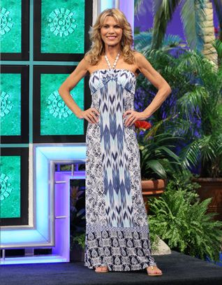 "TOMMY BAHAMA: Poetto Paisley long dress w/empire halter bodice in abstract blue, turq, white ""chevron stripes"", beaded halter straps, skirt w/""chevron stripe"" panel CF & CB, skirt sides in blue 