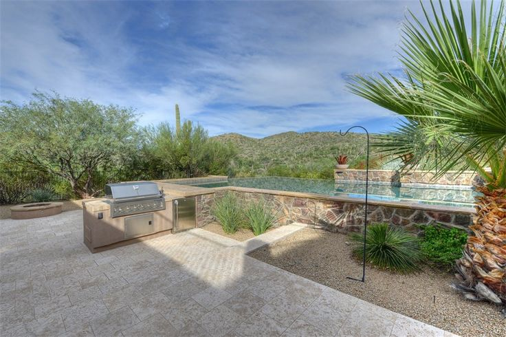 Luxury Backyard Features : pool and kitchen of luxury home  Outdoor Pools & Other Water Features