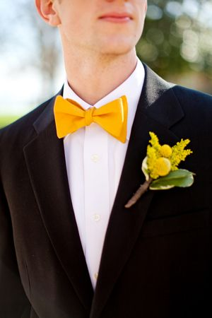 black suite, yellow bow tie