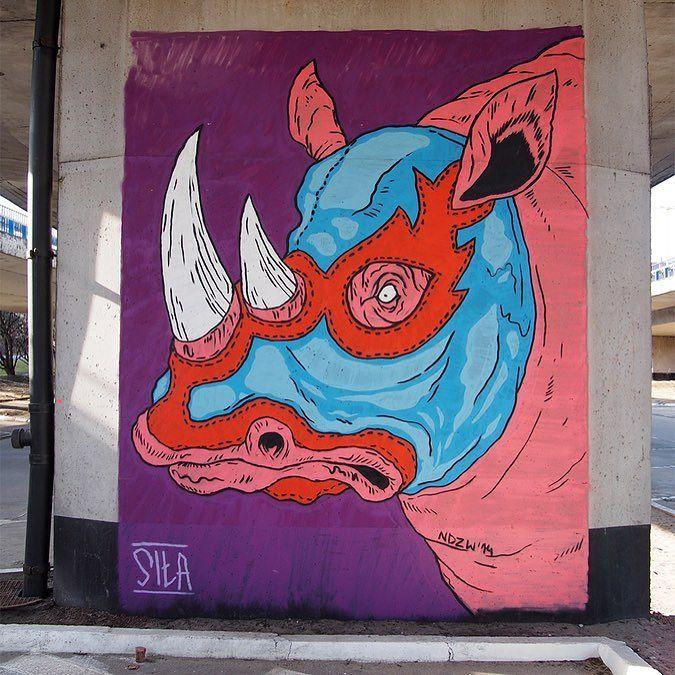 Wrestling Rhino by @ndzwdz #globalstreetart #poland #wrestler #rhino http://globalstreetart.com/ndzw