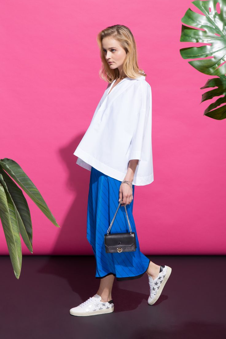 Warm Greetings - Woman. Wearing Balenciaga shirt, DKNY reversible dress, Jimmy Choo bag, Saint Laurent sneakers.