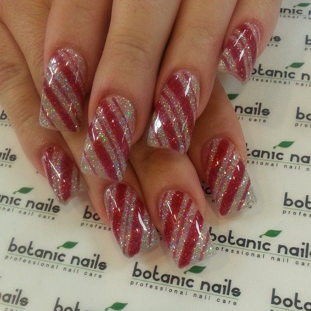 Instagram photo of Christmas-themed acrylic nails by botanicnails