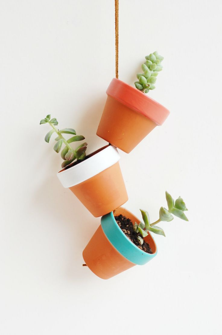 "Desert Colors Tiny Hand Painted Terracotta Planter. Hanging 2"" Mini Clay Pots. Terra Cotta Air Plant Home Decor. Made by Hoopla.. $22.50, via Etsy."