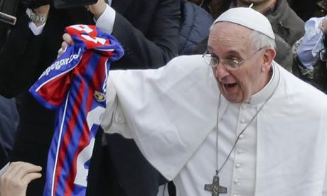 Pope Francis shows his delight at receiving another football shirt.