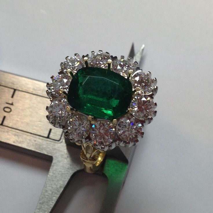 #emerald and diamond coronet cluster style ring in platinum & yellow gold, made entirely by hand, the only way to make a ring of this magnitude ....Lottie Lauder jewellers