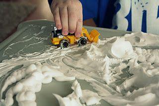 Shaving cream as SNOW (sensory + dramatic = fun)