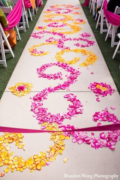 Amazing swirly flower petal wedding ceremony aisle in pink and yellow