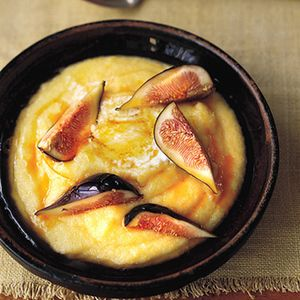 Polenta cooks up just like grits for a smooth, creamy breakfast porridge naturally-sweetened with figs and honey. Recipe from Martha Stewart.