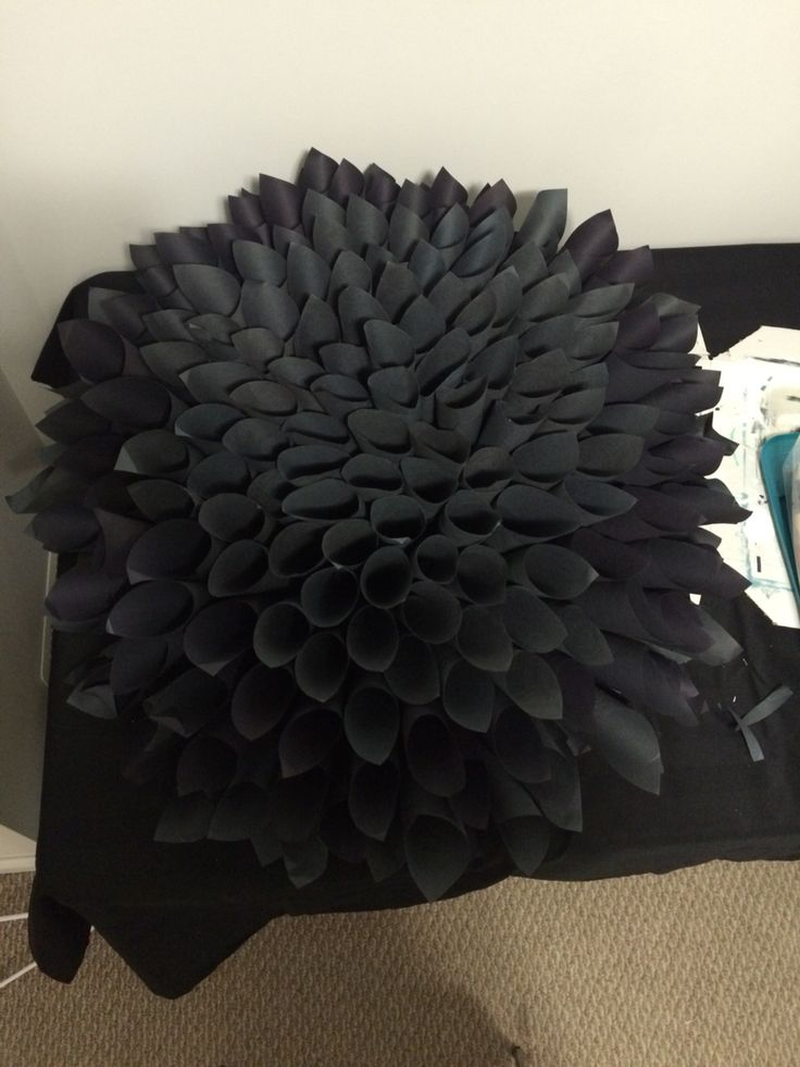 Black construction paper flower