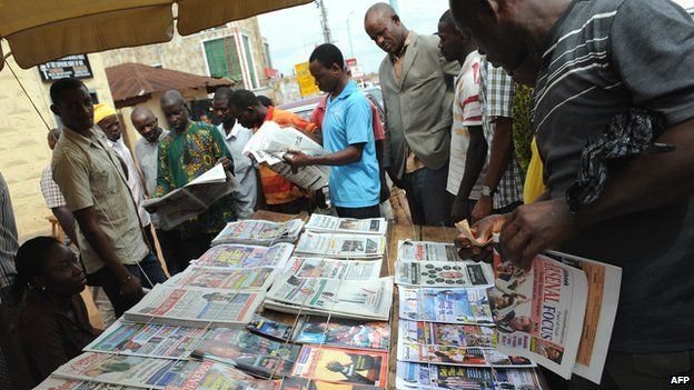 People read the newspaper headlines in Nigeria - 2011Niger'as Brown Envelope Journalism