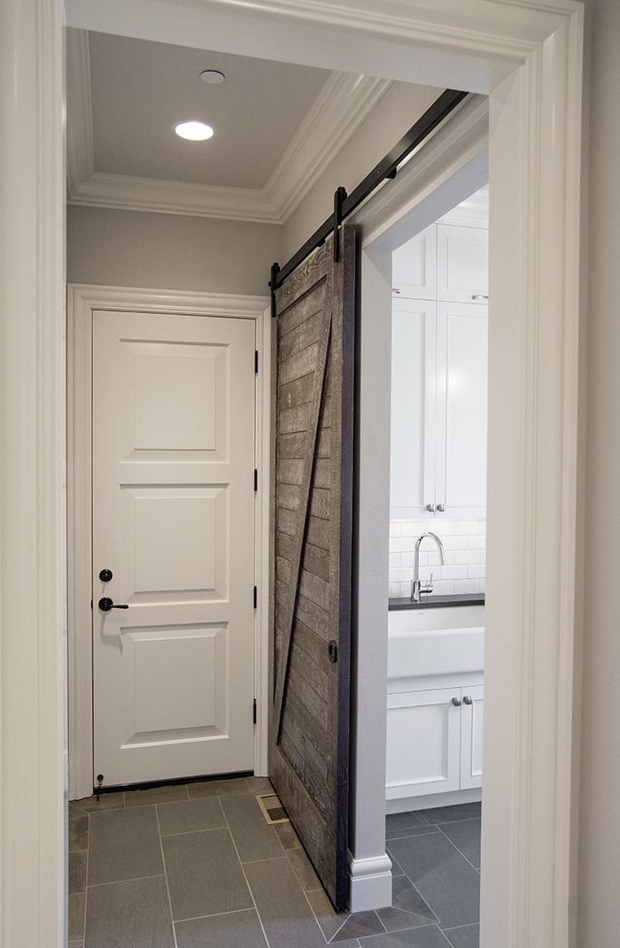 garrison hullinger design used our oden hardware with this beautiful salvaged wood door for their