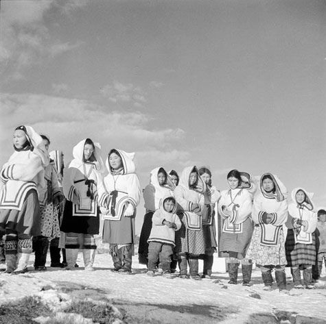 Inuit women in new parkas awaiting the arrival of passengers from R.M.S. NASCOPIE, N.W.T, Canada, August 1946. #vintage #Canada #1940s