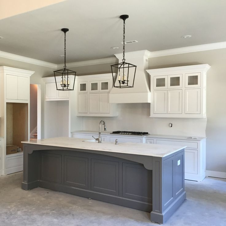 gray island with white cabinets kitchen countertops and tile flooring of our modern farmhouse our vintage nest