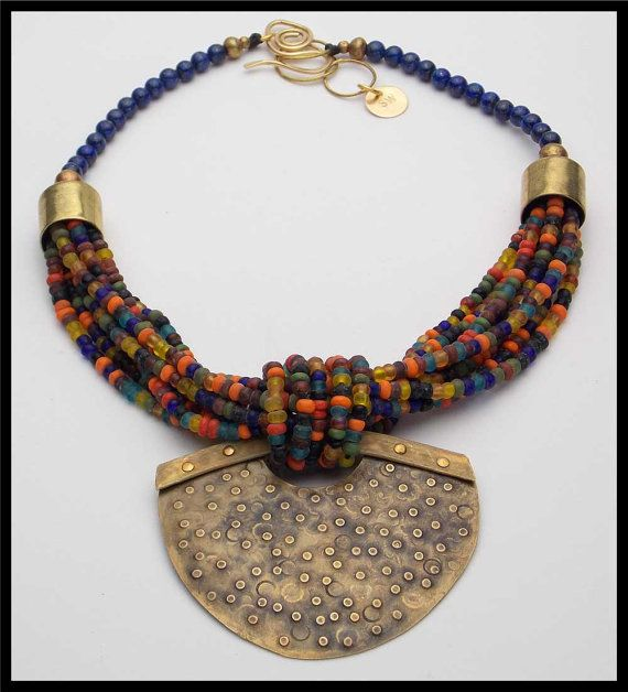 Sandra Webster Jewelry on etsy,MALAGA - Lapis - Handmade Indonesian Glass Beads - Handforged Pendant - 8 Strand Necklace. $210.00. Reminds me of Dorje Designs.