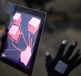 With a glove that looks like it was pried from the hands of Tom Cruise in Minority Report, T(ether) lets you reach inside your iPad and manipulate the virtual environment using various hand gestures. You can pinch objects, pick them up, put them down, or create them from scratch all by using your hand. - Vi Trinh