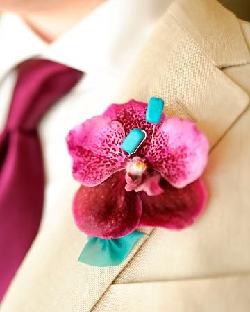 A single Vanda orchid accented with a pair of turquoise beads