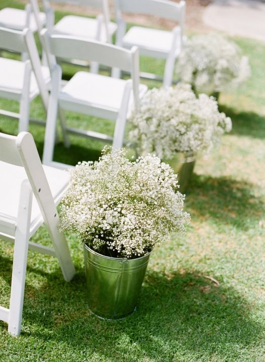 Ceremony aisle lined with buckets of baby's breath # ...