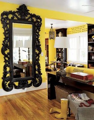 Love the yellow walls and black mirror.