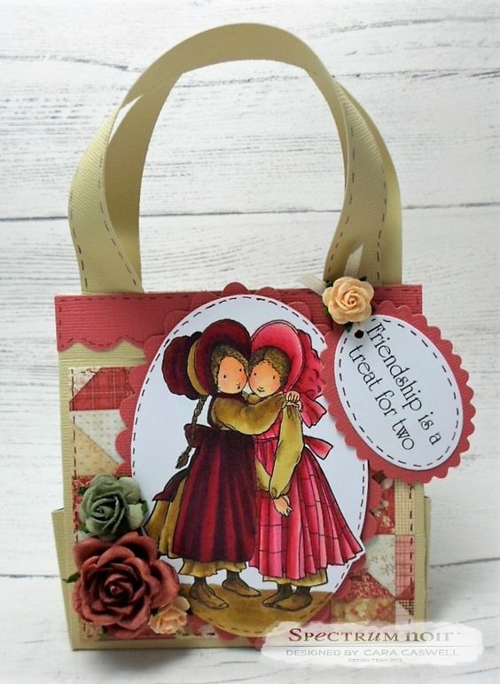 Gift Bag made using Crafter's Companion Holly Hobbie stamp – A Treat for Two coloured with Spectrum Noir Colouring System Markers – Core 72 Collection Only Skin: TN2, FS6, FS2 Browns: GB10, GB8, EB5, EB1 Dresses: DR3, PP5, PP3, EB8, DR7, DR5 Spectrum Noir ColourBlend Pencil Overlay using Both Soft Tints and Bold Brights Designed by Cara Caswell #crafterscompanion #spectrumnoir