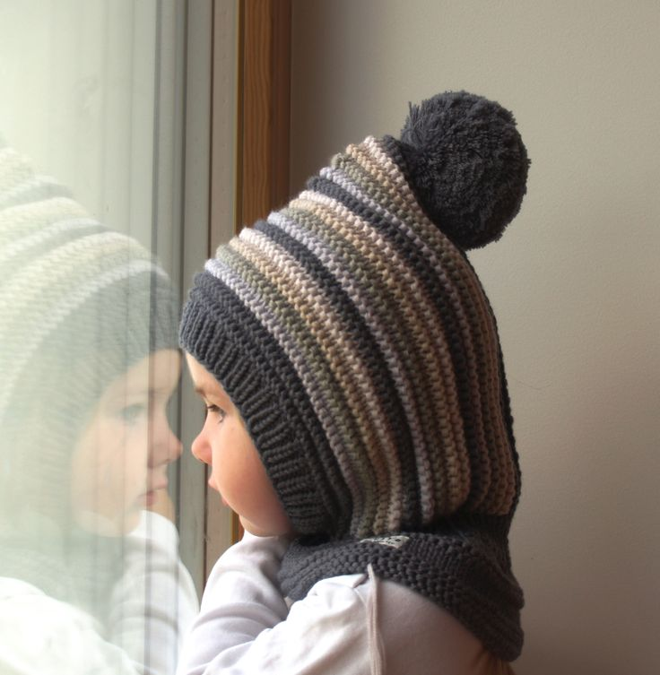 Waldorf inspired winter and snow hat. Hand knitted hoodie / balaclava hat for baby, toddler, child. Made from 100% merino wool in dark grey with stripes in light grey and beige. Soft and very functional - perfect to keep the little ones warm and cozy during cold days           Size: 6-12 Months  1-3 Year 3-6 Years 6-10 Years           Price: 39$