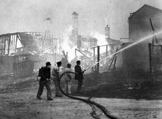 I had to pin this - I could find nothing Australian in the history section - I am fixing the situation! Volunteer fire fighters spray the blazing ruins of homes in Wentworth Falls during the fires (by National Archives of Australia - 1957)