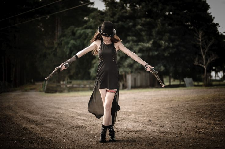 #steampunk #cosplay Don't mess with me. Black dress and boots. 2 guns and a hat. Photography by: Johan.W