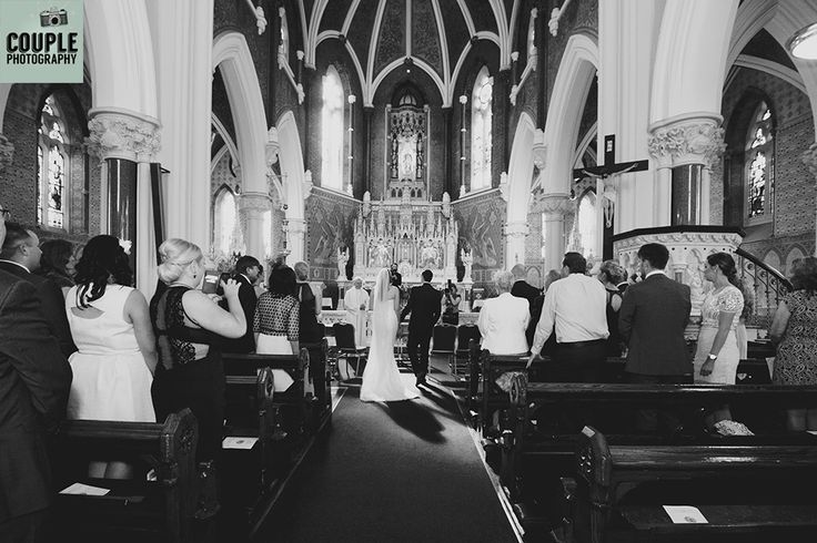 Walking down the aisle to get married.  Black & white wide lens photograph. Weddings at The Knightsbrook Hotel Photographed by Couple Photography.