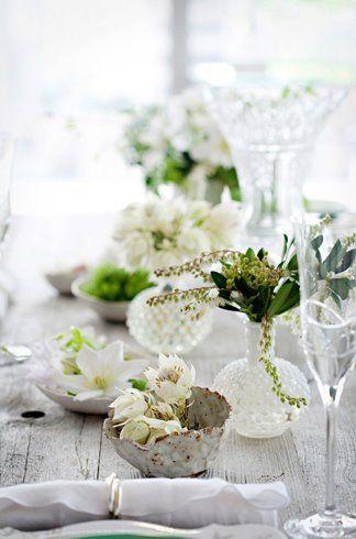 Elegant white table setting on nice smooth wood table