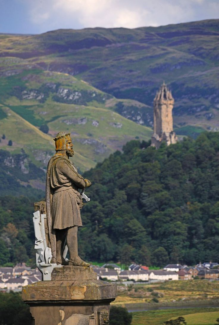 The Robert the Bruce statue on Castle Esplanade, Stirling Castle, with the Wallace Monument in the distance