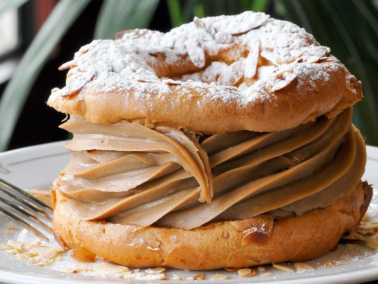 The Paris-Brest, named after the Paris-Brest-Paris bicycle race, looks like a bicycle wheel, with two choux pastry circles and a praline butter cream.