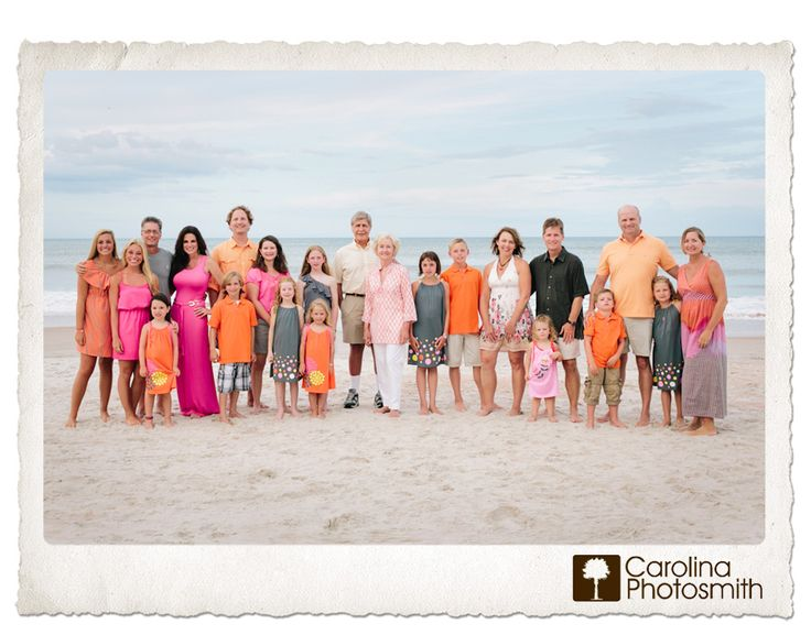 Large family of 22 in pink, orange and grey. Coordinated, but far from matching. www.carolinaphotosmith.com
