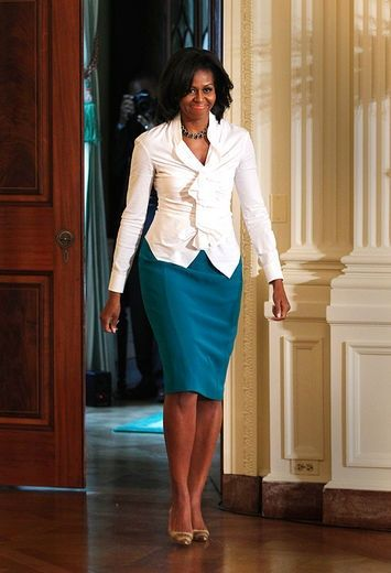Michelle Obama. Like the skirt.  Love this style from the white blouse/top to the skirt.