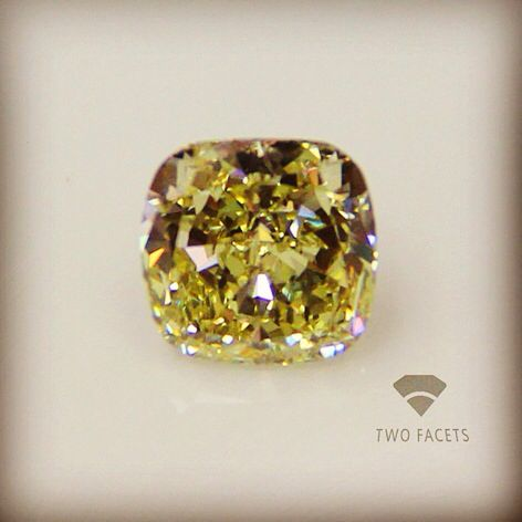 Light fancy 12.10ct cushion cut diamond. Uncertified but definitely not understated - contact for more details