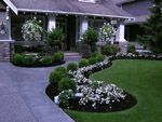 Front yard makeover slideshow. Everything I love in a bed. Raised, no curbing, with plants in rows. Gorgeous. Love the small trees by the porch and of course those amazing hanging baskets.