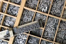 Movable metal type, and composing stick, descended from Gutenberg's press.