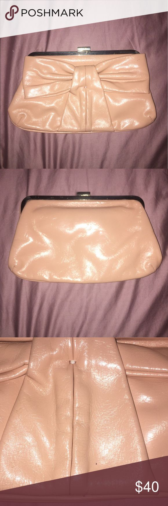 Melie Bianco beige bow clutch Used and in excellent condition. Super cute. It came with a chain but I removed and and no longer have it. There are 2 hooks that you can clip a chain or strap to if you want (shown in pic). One tiny spot that is barely noticeable (shown in pic) Melie Bianco Bags Clutches & Wristlets