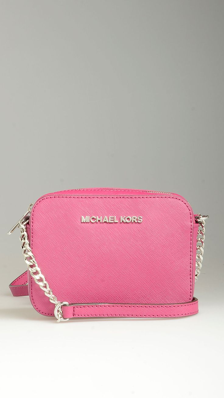 Silver hardware detailing purple Saffiano leather crossbody bag featuring top zip, chain detailing crossbody strap, three inner card slots, a zippered pocket, monogram lining, 5.9'' x 1.7'' x 4.3'', 100% Saffiano leather.
