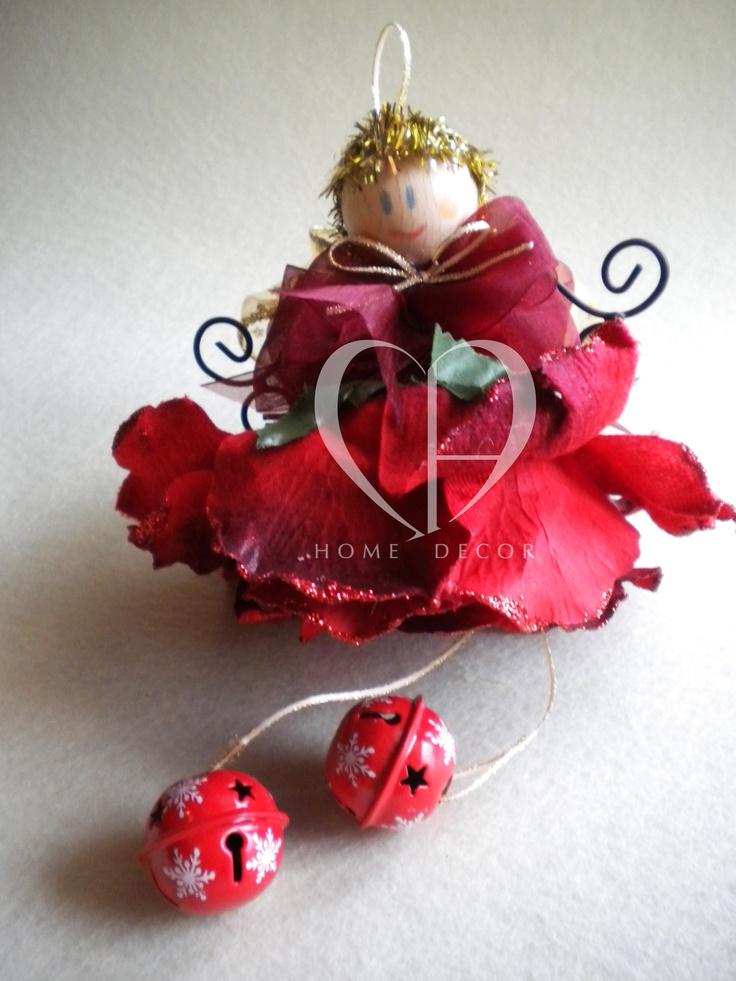 fiore di velluto, ali in ferro battuto o feltro, sonagli in tinta