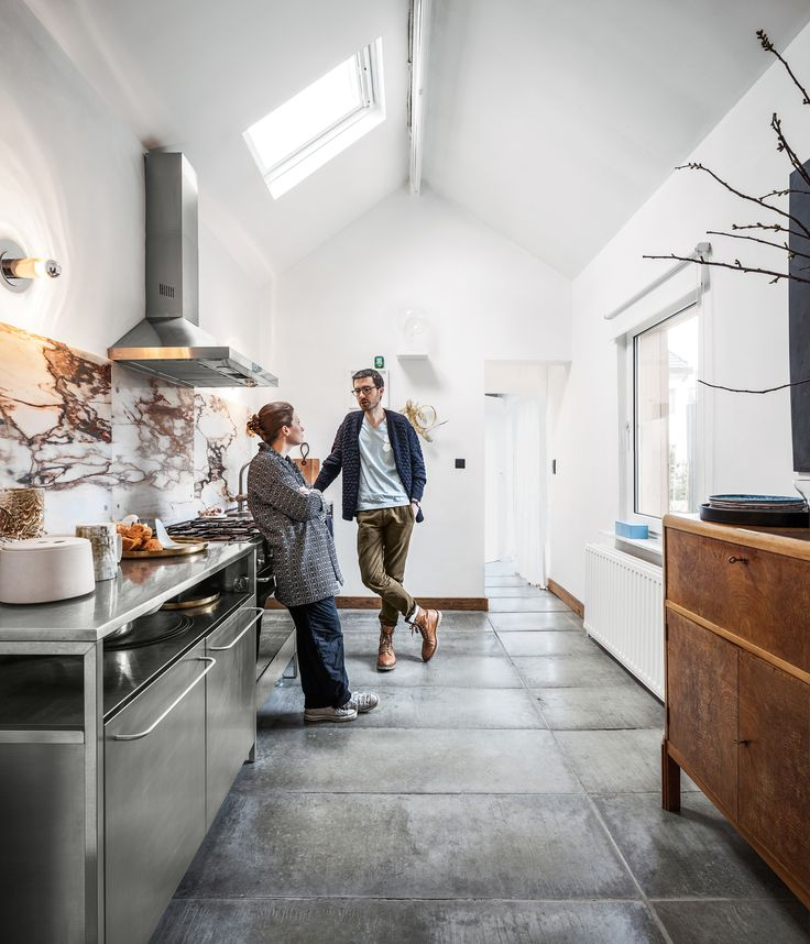 By introducing chic new elements, a Belgian couple takes a gentle approach to transforming a tired house into a vibrant workshop.