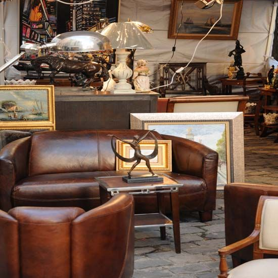 Create a home business buying and selling used furniture by finding furniture bargains at farm auctions and reselling them at flea markets.
