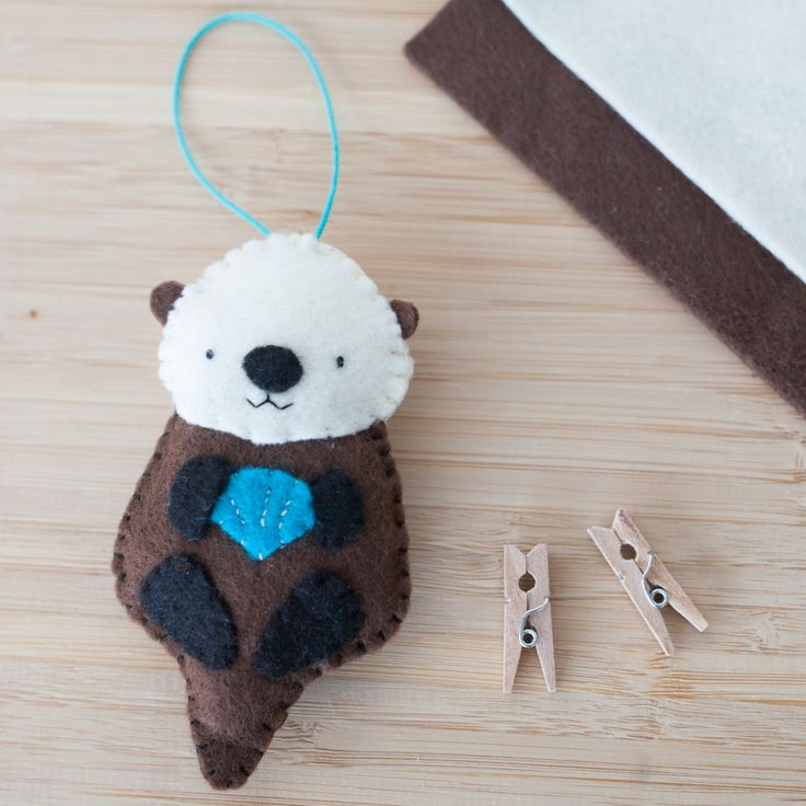Handmade Felt Otter Ornament, Decorative Felt Animal Ornament, Felt Otter, Nursery Decoration, Home Decor, Baby gifts, Sea Creatures by ThreadAndFelt on Etsy https://www.etsy.com/listing/220971380/handmade-felt-otter-ornament-decorative